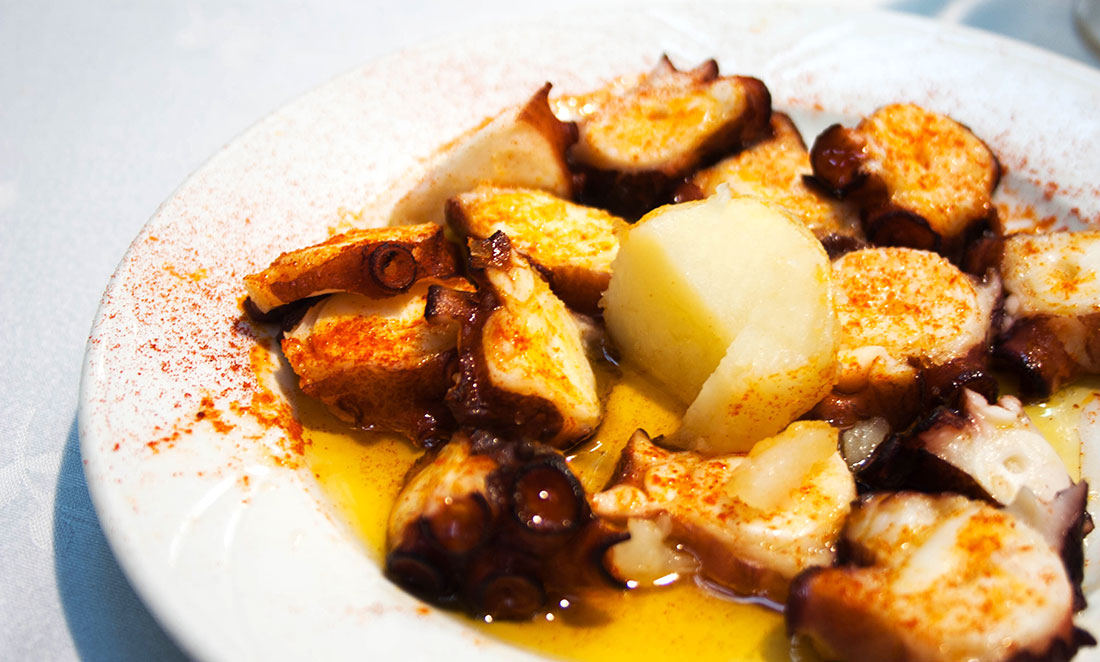 Pulpo (Octopus) with potato and paprika, a traditional dish.